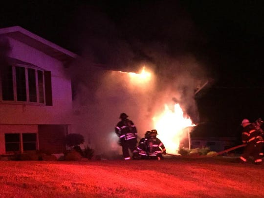Firefighters battle a blaze at 6 Dorchester Drive in