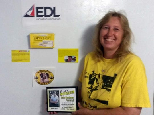 Dawn Pietroski from EDL Packaging Innovations in DePere poses with the Dillon Mueller Safe Business Award.