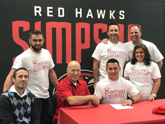Anderson wrestler Rodney Kincaid, seated at right, recently signed a scholarship offer and letter of intent to compete for Simpson University.