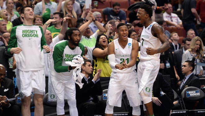 March 24, 2016; Anaheim, CA, USA; Oregon Ducks guard Kendall Small (21), forward Jordan Bell (1) and the bench celebrate during the 82-68 victory against Duke Blue Devils during the second half of the semifinal game in the West regional of the NCAA Tournament at Honda Center. Mandatory Credit: Robert Hanashiro USA TODAY Sports