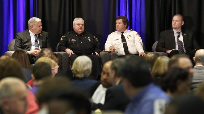 From left, city manager Brent Trout, Topeka Police Chief Bill Cochran, Topeka Fire Chief Craig Duke and Charles Kitt, the district attorney's chief of staff, participate in a panel discussion during Topeka's 2018 State of the Community event.