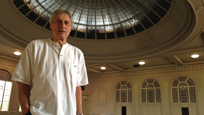 Wolfgang Rosenau stands in the former worship space on the second floor of a building for sale across from Sherman Park. Rosenau wants to see the building, which used to house Schrager Auction Galleries, used to benefit the local community.