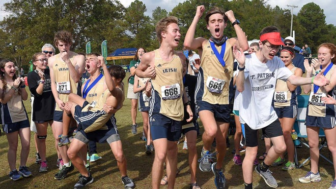 The St. Patrick Irish celebrate winning the Class 2A team championship on Saturday, November 4, 2017, in the MHSAA Class 6A-4A-2A State Cross Country Meet at Choctaw Trails in Clinton, Miss.