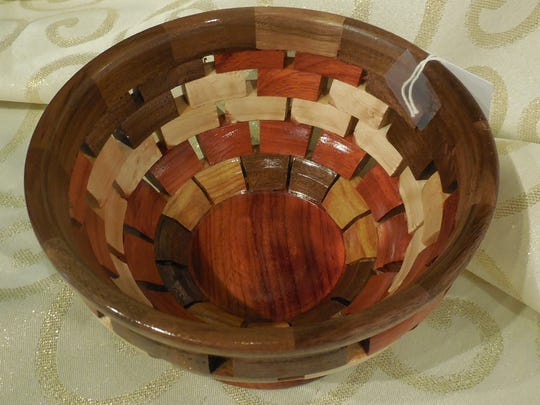 An intricate segmented wooden bowl by Jerry Heckendorn would be an excellent gift.