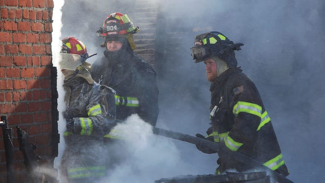 Firefighters from multiple districts responded to a two story house fire in rural Gaston Wednesday afternoon. The blaze, fueled by strong sustained winds, was made even more difficult to fight by having to ship water to the scene from a convoy of tanker trucks.