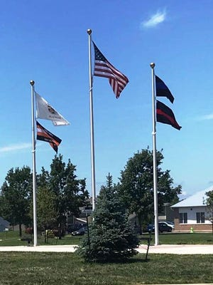An updated array of flags flies at First Responders Park in Germantown Hills. On the left pole, a flag that pays tribute to public-works employees joins the Illinois state flag. On the right pole are flags that honor police and fire personnel.