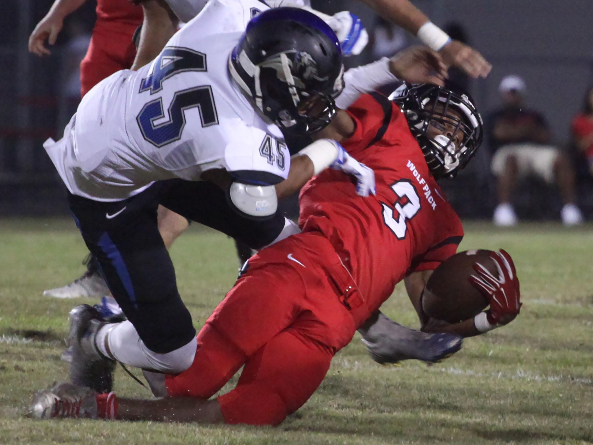 South Fort Myers' Ke'Shon Murray is tackled by Ida Baker's Robert Cobb during a game at South Fort Myers on Friday night.