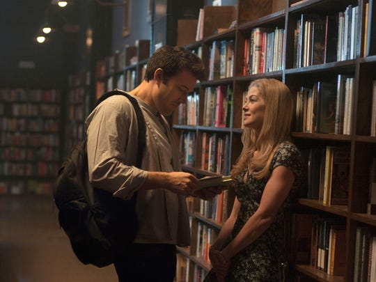 """Ben Affleck and Rosamund Pike appear in a scene from """"Gone Girl."""" The film, based on the best-selling novel, is Tony Wittkowski's top pick."""