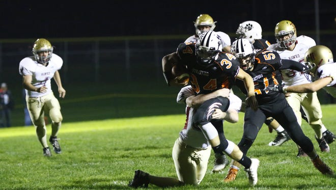 Stratford's Kade Ehrike attempts to run through a tackle attempt during the Tigers matchup with Rib Lake/Prentice last Friday.