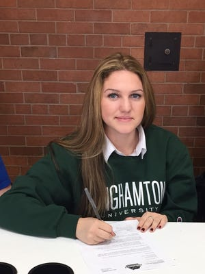 McKayla Hernandez a senior at St. Mary's High School in Manhasset, N.Y., signs a National Letter of Intent to play basketball at Binghamton University.