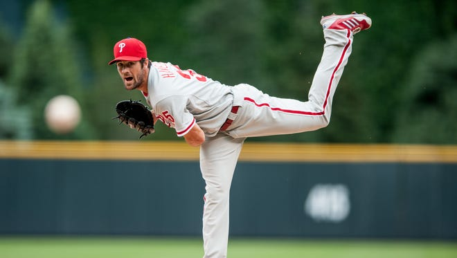 DENVER, CO - JUNE 16: Cole Hamels #35 of the Philadelphia Phillies pitches against the Colorado Rockies in the first inning of a game at Coors Field on June 16, 2013 in Denver, Colorado. (Photo by Dustin Bradford/Getty Images)