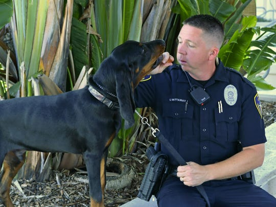 Cocoa Police Officer Chris Hattaway with his K9 partner Copper, a 5 month old black and tan Coonhound recently sworn in to serve Cocoa in searches for missing persons, and in public relations in the community. This talented pup was donated to the department by Cocoa Council Member Brenda Warner, and he has his own Facebook page, K9 Copper.