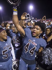 Cameron McGrone (44) celebrates a win Sept. 22, 2017.