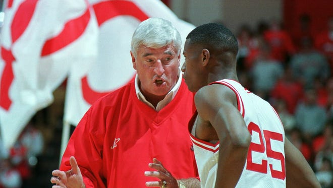 11/1/98--Indiana University Head Coach Bob Knight explains to A.J. Guyton (25) what is expected during the Hoosiers win over the North Melbourne Giants Saturday afternoon at Assembly Hall. (Staff Photo/Eric Kane) file # 33698 with story