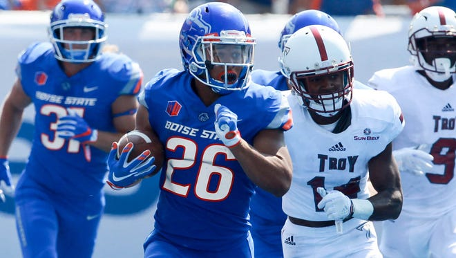 Boise State cornerback Avery Williams runs back a punt for 58 yards in the Broncos' 24-13 win Saturday over Troy. Boise State is the early leader in our weekly Mountain West power rankings.