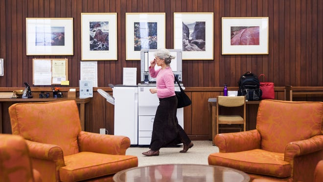 "Katharine Gorsuch, a Jewish studies student at Mary Baldwin College, walks through the school's library on Wednesday, March 4, 2015. Gorsuch said Mary Baldwin would be a ""fantastic home"" for any student hoping to transfer from the soon-to-close Sweet Briar College."