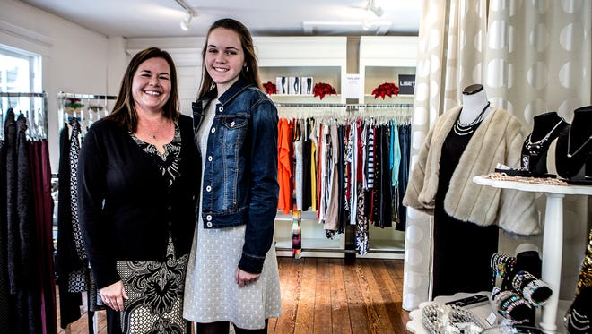 Samantha Smith stands with her daughter Sabrina, 15,  in the James Store. Smith who has been running the store with her mother (Cecilia, not pictured) for the past 10 years. Smith recently sold the business which will move to being an online only store.