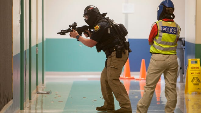 Participants ran through several scenarios during active shooter training at Little Valley Elementary in St. George on Wednesday, June 6, 2018.