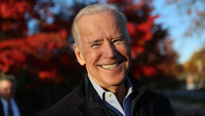 Vice President Joe Biden smiles after voting in the presidential election on Tuesday morning at A.I. DuPont High School.