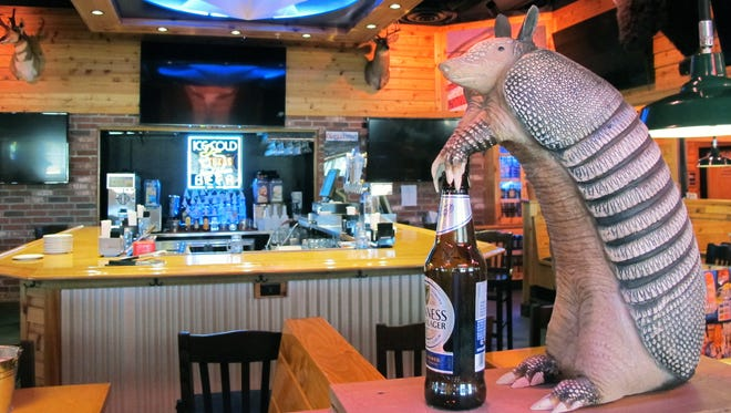 An armadillo grabs a beer at the bar in Texas Roadhouse, which opened Monday in Restaurant Row along Collier Boulevard at U.S. 41 East.