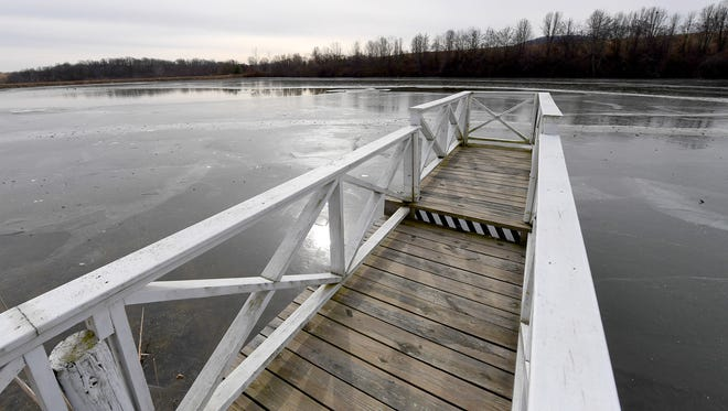 A dock leads out over the waters of a lake on the grounds of Gaie Lea, located on Bells Lane in Staunton.
