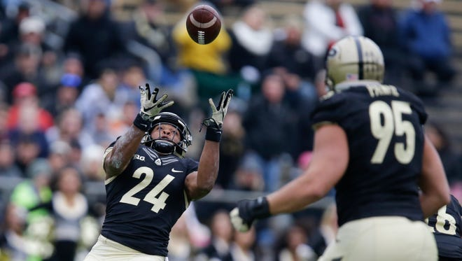 Purdue cornerback Frankie Williams (24) intercepts a pass in front of teammate Evan Panfil during the second half of an NCAA college football game against Nebraska in West Lafayette, Ind., Saturday, Oct. 31, 2015. Purdue defeated Nebraska 55-45. (AP Photo/Michael Conroy)