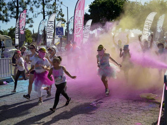Runners started out Saturday's Color Vibe 5K run in