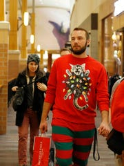 Colton Barton of Des Moines wears a festive holiday outfit as he searches for Black Friday deals at Jordan Creek Town Center mall in West Des Moines on Black Friday in 2016.