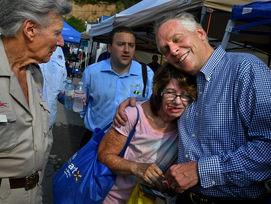 Virginia Gov. Terry McAuliffe gives a hug to Patricia