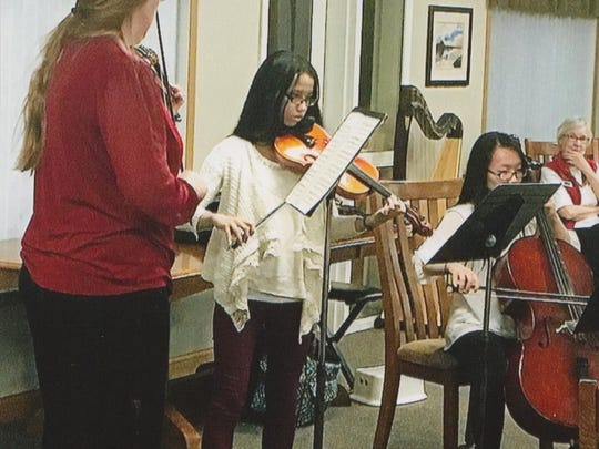 As pictured on Feb. 14th, orchestra students of Kirsten Hornby and Ann Johnson, from Wausau and D.C. Everest schools, performed for members of the Village Cooperative at their Valentine Dinner.