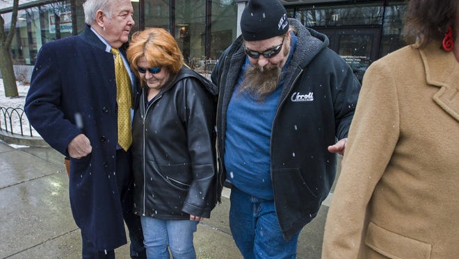 Patricia Savage, second from left, and Bernard Savage, center, leave the Federal Building in Burlington on Monday, March 7, 2016.