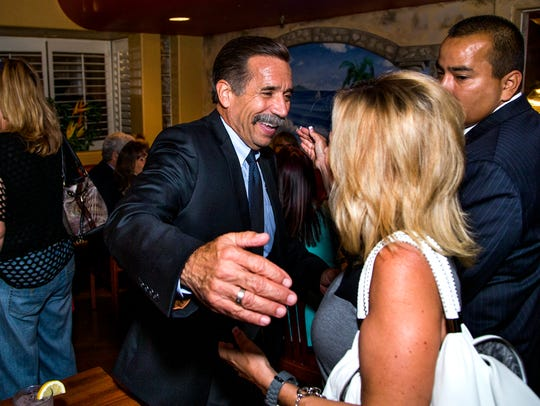 Glendale mayoral candidate Mark Burdick (left) greets