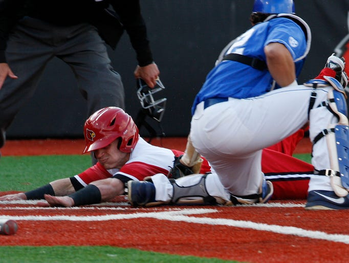 U of L's Sutton Whiting, #1, was tagged out at home by UK catcher Micheal, cq, Thomas, #42, during their game at Patterson Stadium.   Apr. 15, 2014