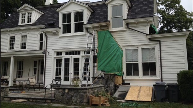 Firefighters responded to a two-alarm blaze Saturday night, July 26, 2014, at 47-51 Pound Ridge Road in Bedford.  No injuries were reported.