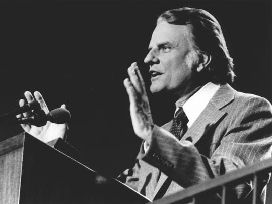The Rev. Billy Graham preaches during a 1977 crusade