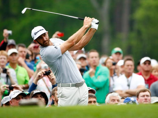 Dustin Johnson hits a tee shot on the 12th hole during