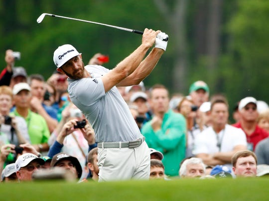 Dustin Johnson hits a tee shot on the 12th hole during a practice round at Augusta National Golf Club.