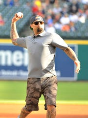 Former Tiger pitcher Joel Zumaya throws out the ceremonial first pitch before the game against the Toronto Blue Jays at Comerica Park Tuesday.