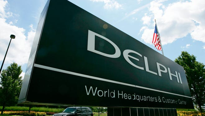 A car passes Delphi's world headquarters in Troy, Mich.