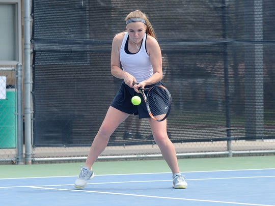 Abilene High's Katherine Morris sets up a backhand