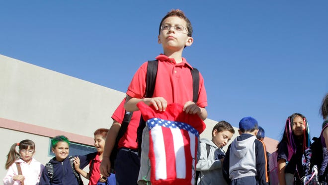 A student with an American flag hat in Rio Rico, Ariz.