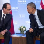 President Obama and French President Francois Hollande meet in 2014.