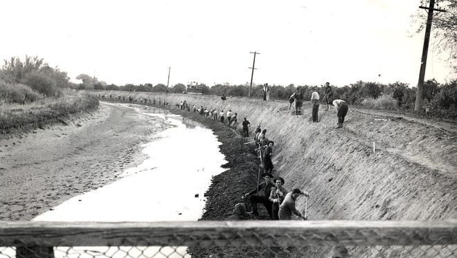 Italian prisoners of war repair the Arizona Canal circa 1943. To help deal with a labor shortage during World War II, SRP used POWs to help maintain the canals.