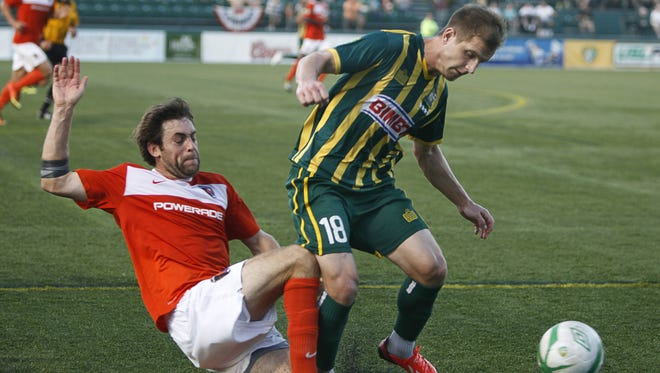 A file photo of the Rhinos' Tyler Polak trying to control the ball during a game this season against the Charlotte Eagles.