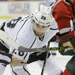 Los Angeles Kings center Jarret Stoll (28) keeps his eyes on the puck during a faceoff in the second period of an NHL hockey game against the Minnesota Wild in St. Paul, Minn. on Nov. 26, 2014. The New York Rangers signed recently arrested Kings center Jarret Stoll on Monday, a few months after he pleaded guilty in a felony cocaine case. Stoll gives the Rangers a top faceoff man and penalty killer.