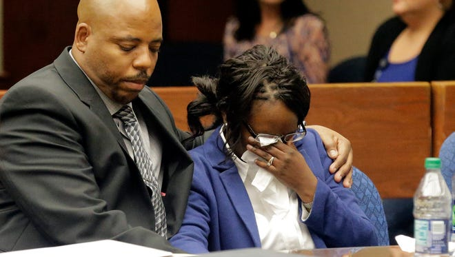 Wakesha Ives is comforted by her husband, James Ives, after hearing the guilty verdict on a charge of criminally negligent homicide Sept. 19 in the 384th District Court. She was charged in the death of her 5-month-old daughter after the baby was left in a car for more than eight hours outside of Riverside High School.