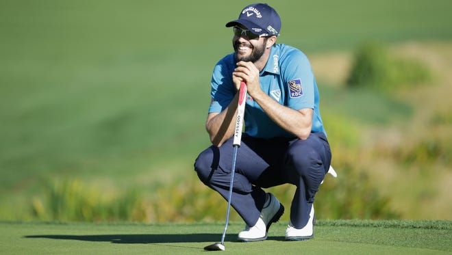 Adam Hadwin of Canada lines up a putt on the 18th hole during the third round of the CareerBuilder Challenge at La Quinta Country Club on January 21, 2017 in La Quinta, California.