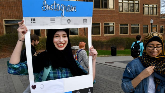 Victoria Montefusco tries on a hijab and gets her photo made by UT Muslim Student Association member Hoor Temuri during World Hijab Day on Wednesday, Feb. 1, 2017. Similar events are planned worldwide and have been taking place since 2013, when a New York woman came up with the idea as a way to promote understanding and religious tolerance.