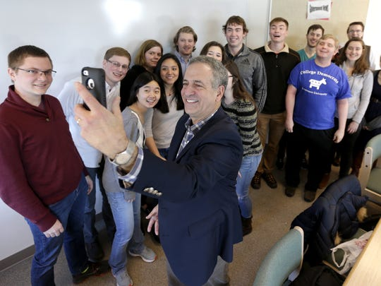 Russ Feingold takes a selfie Thursday with a group of college students after talking with them about college affordability  at Lawrence University in Appleton.