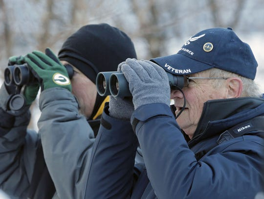 Mike Blise, left, and Bruce Fassbender, take part in eagle monitoring along the Fox River on Dec. 9. Ron Page/USA TODAY NEWTORK-Wisconsin